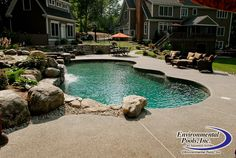 Aggregate decking with dive rock www.environmentalpools.com