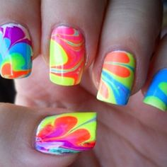 Water Marble Nails: You put water in a bowl and drop random colors of nail polish in it. then you stir it with a toothpick and put petroleum jelly on your fingers, so that the nail polish only gets on your nails. then you stick your fingers in the bowl. Do It Yourself Nails, Do It Yourself Fashion, How To Do Nails, Fake Nails For Kids, Ongles Tie Dye, Tie Dye Nails, Cute Nails, Pretty Nails, Hair And Nails
