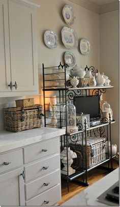 Add a baker's rack or utility cart to dead space in a kitchen. It's a great way to maximize storage and display pretty serving pieces.