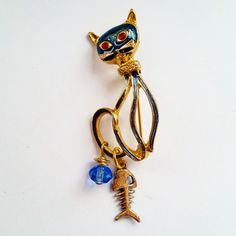 Vintage Cat Brooch with Fish Bone & Blue Crystal Dangles by DirtyPopAccessories on Etsy