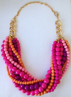 This statement necklace has chunky beads in vibrant shades of pink, orange, and purple for a perfect pop of color! This necklace can also be customized with different bead colors and with gold, silver, or rose gold chain! It makes an especially fabulous statement for a fashion forward bride or for her bridesmaids! Please inquire about customization options!    Hot Stuff statement necklace by Nu Sans Bijoux.    This amazingly vibrant couture-quality piece is handmade to order!    An…