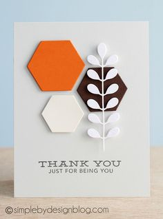 handmade card ... clean and simple design ... three die cut hexagons ..... orange, black and white ... die cut stem and leaves  on top ... luv the strong lines and bright color of the central montage ...