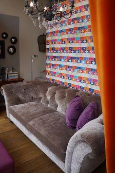 Cokethorpe sofa window featuring Osborne and Little Penguin Library wallpaper and Harlequin Folia velvet, Wesley Barrell Bristol showroom