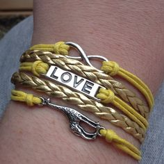 """Giraffe Bracelet Cute bracelet on gold and yellow cords. This has a chain extender and lobster clasp on the back. New in package. This can latch from about 7 1/2"""" to 9"""" Jewelry Bracelets"""