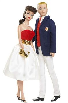 Barbie and Ken circa 1960's style. I still have this blond Ken doll.