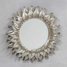 This round silver flame mirror offers a chic elegant design that is certain to…