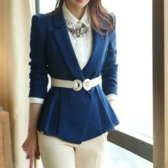 Classy with blue blazer, white shirt, belt, and pants.