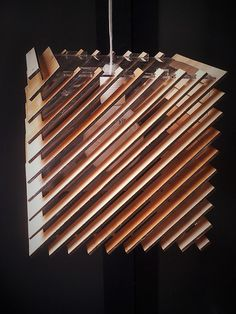 laser cut pendant lamp in plywood and plexiglass