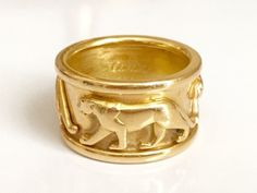 This iconic Cartier panther ring is a highly collectible piece. It is done in…