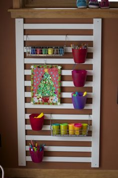 Re-purposed crib rail + ikea hanging storage, I have been wanting to do this. @Heidi Soto for the girls room