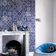 Living room with chimney breast and blue artisan tiles