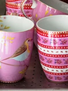 red and pink mugs