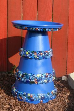 "Bird Bath that is easy to make and fun. use a 10"", 12"" and 14"" terra cota pot. Paint them, glue together with caulk and decorate. Add a 16"" terra cota pot base as the top, paint and caulk onto the base."