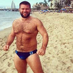 Adorable, furry and cute #Speedo Cub at the beach