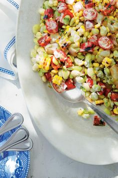This grilled corn and bean salad is a take on traditional succotash and features fresh grilled corn, butter beans, bell pepper and tomatoes.The creaminess comes from an herbed mayonnaise mixture.    Recipe:Grilled Corn-and-Butter Bean Salad