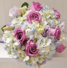 pale blue hydrangea with purple roses