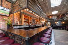 Redford, An Unapologetically American Tavern: Designed by Parisa O'Connell Redford has a rustic/nostalgic vibe with a vintage tractor wheel behind the bar, a 48-star American flag framed on the wall, and light fixtures made from old bread boxes.