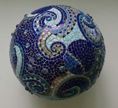 mosaic orb garden gazing ball sphere cobalt blue stained glass waves spiral round fine ar t mosaic copper beads marble terracotta $320.00 USD Materials: stained glass, copper, marbles, beads, flowers, grout, mortar, sealer, blue white china, blue white dishes, blue glass, white glass, terracotta