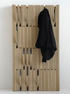 Wall-mounted coat rack PIANO by Feld | #design Patrick Seha #wood #interiors