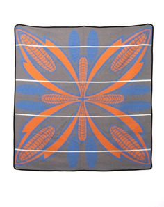 The Basotho Blanket - Sefate Poone is a very traditional Piece of Design. It symbolizes good crops, wealth and fertility. The Poone is given as a present to honor e. an important visitor.