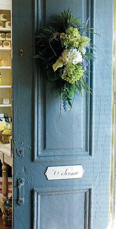 Lovely shade of blue for a front door of a cottage