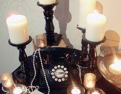 A Roaring 20s Wedding Show | Flickr - Photo Sharing!  You can never go wrong with pearls and beautiful candles.