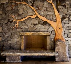 Beautiful Madrone and stone fire hearth. this is the most beautiful fireplace I have ever seen! If I have the chance to put a fireplace in my house- this is the one!