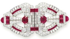 The circular-cut diamond shield-shaped plaques decorated with variously-cut rubies, enhanced by baguette and trapeze-cut diamond detail, mounted in platinum, circa Ruby Jewelry, Jewelry Art, Antique Jewelry, Vintage Jewelry, Fine Jewelry, Jewelry Design, Gemstone Jewelry, Jewlery, Bijoux Art Deco