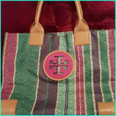 Authentic Tory Burch Ella tote This beautiful preloved multicolored tote still has lots of life in  it. There is an ink stain on the inside and also one of the handles shows some wear but doesn't harm the bag. The bottom, sides, etc., are all in great condition.  You're welcome to make an offer using the offer button ?? Tory Burch Bags Totes