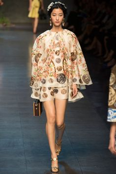 Dolce & Gabbana Spring/Summer 2014 Ready-to-Wear Collection via Designers Domenico Dolce & Stefano Gabbana; modeled by Ji Hye Park