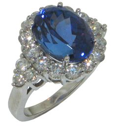 9.12 Ct. TW Oval Cut Tanzanite in Diamond Halo Accented 14 kt. Ring