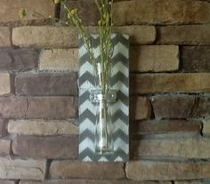 Hey, I found this really awesome Etsy listing at http://www.etsy.com/listing/150662534/wood-wall-vase-grey-and-white-chevron