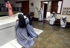Nuns of different orders pray at the tomb of Mother Teresa at the Missionaries of Charity in Calcutta, India, Friday, Oct. 17, 2003.