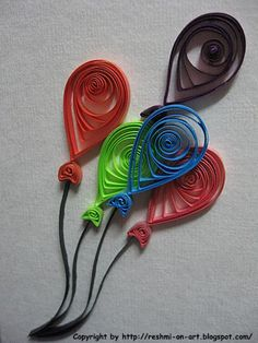 Quilled birthday balloons for a greeting card