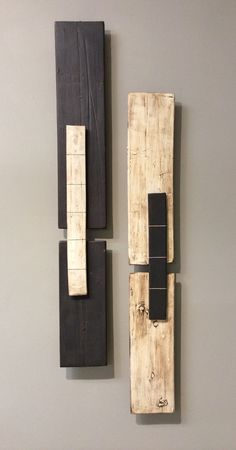 Two Bars by Lori Katz. Slab-built *stoneware* with *slips:slip*, underglaze, glaze. Backed on wood and wired to hang simply on one or two picture hooks. Sold in a pair, as shown. Dimensions refer to arrangement as shown. Espresso Bar is 33''H x 4.75''W. Cream is 32''H x 4.5''W.