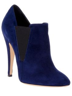 Blue suede ankle boot from Casadei featuring a round toe, a contrasting black elasticated panel to the sides, a suede covered stiletto heel and a nude leather sole.