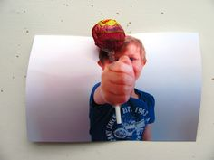 Lollipop card, all you need is a photo with a fist in it & a crafting knife. Above & below fist cut out a triangle (aprox. 1 cm).