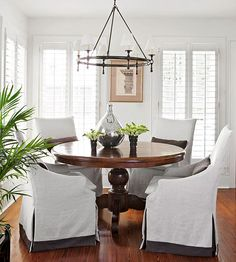 Beautiful slipcovered chairs, round dining table
