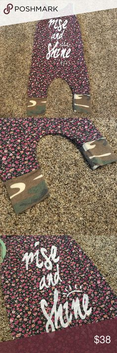 Rags to Raches Rise and Shine Floral Camo Romper Love this company! Size 6-12 months floral and camo rise and shine romper! Great condition! Rags to Raches Bottoms Jumpsuits & Rompers
