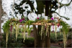 Alice in Wonderland Wedding ~hanging floral and time piece decor
