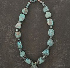Handmade statement beaded necklace A rustic Turquoise necklace, hand carved raw Turquoise x Greek Mykonos pendant.