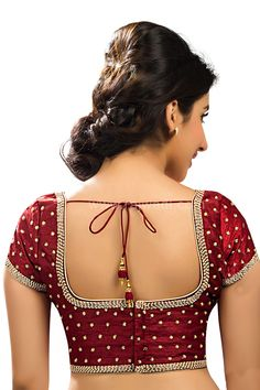 Get a glowing personality with this Raw Silk fabric Maroon coloured ready choli crafted with stone and cutdana work.