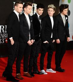 One Direction! Haha if you look  they are all wearing fancy shoes and then there's our little snowflake wearing white and black tennis-shoes:)