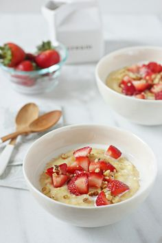 Recipe for strawberries and cream breakfast polenta. Creamy polenta with brown sugar and vanilla, topped with strawberries, half and half, and nuts.