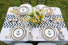 Love sets sail with nautical wedding ideas in this serene styled shoot at Lake Champlain in Vermont with the crisp palette of navy, blue, and lemon yellow.