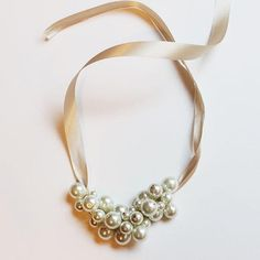 Pearls are one of the most iconic elements of jewelry, and they've withstood the fashion trends. Versatile, classy and feminine: What more do you need? Learn to make a DIY pearl cluster necklace that exudes all of these qualities. - DivineCaroline.com