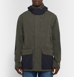 Designed exclusively for MR PORTER. The Workers Club's dark-olive and midnight-blue parka is crafted from hard-wearing H2O Protector® cotton-canvas, making it a smart choice for both inclement outdoor conditions and everyday wear. This functional piece is constructed with a detachable hood, reinforced elbow patches and taped seams for optimum wind and water resistance.