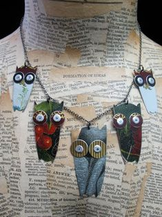 One of my favorites!!!!  recycled tin owls  So freakin' cute!