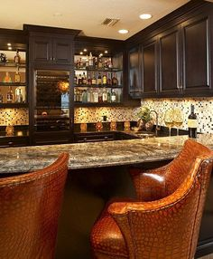 Like the wine cooler and shelving. But would use lighter cabinets and change the wall tile. Too much pattern with the extreme pattern on the counter top.