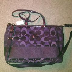 Coach Baby Bag Brand new, never been used Purple baby bag with two small straps and one larger strap, has many compartments on the inside with a mat to change your little one on! Coach Bags Baby Bags